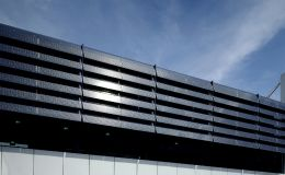 Shadovoltaic glass louvers